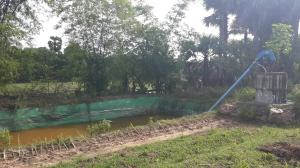 Tarpaulin pond and Rovai pump - © Yim Soksophors